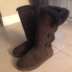 Medium length, brown UGG boots with buttons
